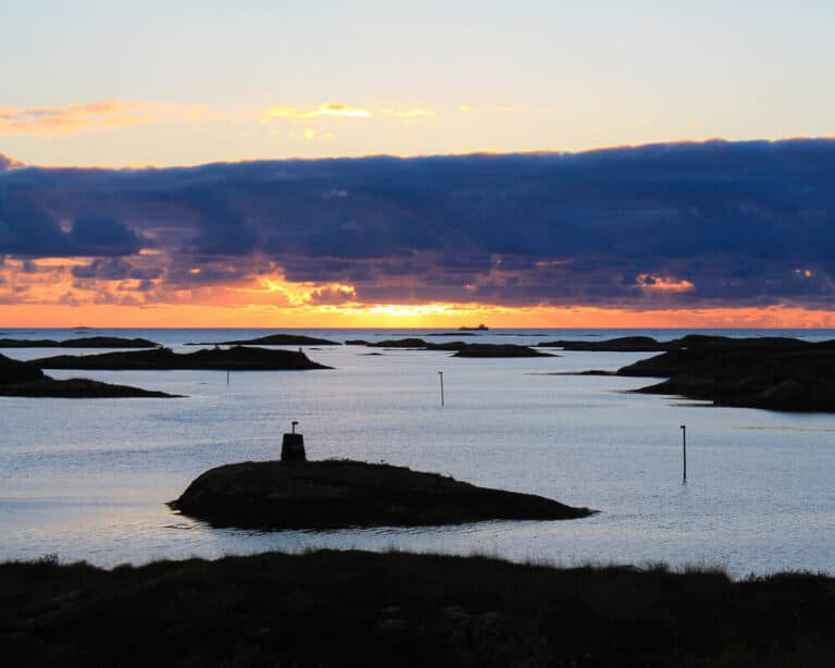 Sunset at sea with many small islands, Norway